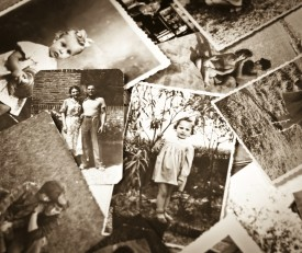 Black and white family photos lying on each other.